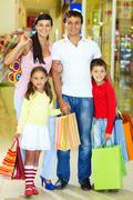 Portrait of happy family during shopping Stock Photos