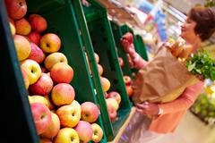 Image of fresh apples in supermarket Stock Photos