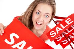 Portrait of amazed shopper with sale tags looking at camera Stock Photos