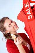 Portrait of happy woman with credit card on sale Stock Photos
