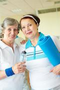 portrait of aged women looking at camera in sport club - stock photo