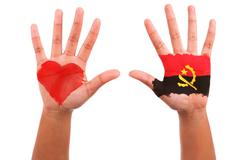 African hands with a painted heart and angolan flag, i love  angola concept Stock Photos