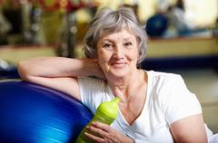Portrait of senior woman in sportswear looking at camera and smiling Stock Photos