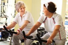 two senior women training in health club - stock photo