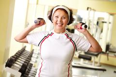 Pretty senior woman pumping muscles Stock Photos