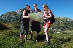 Young people hiking in the mountains Stock Photos
