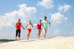 four friends having fun in summer - stock photo