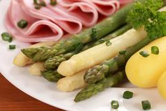 Cooked asparagus with ham and potatoes Stock Photos