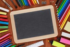 empty black chalkboard with copyspace - stock photo
