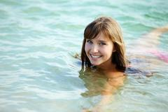 portrait of wet attractive woman in the water - stock photo