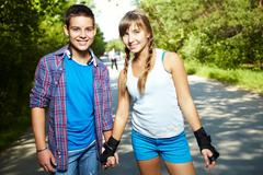 Stock Photo of couple of happy teens looking at camera outside