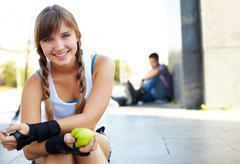 Cute teenage girl looking at camera in park Stock Photos