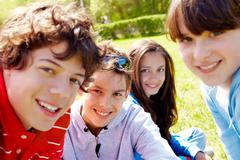 Portrait of happy teens looking at camera in the park at summer Stock Photos