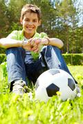 Portrait of happy lads with ball near by looking at camera Stock Photos