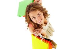 Above angle of a girl with paper bags looking at camera and smiling Stock Photos
