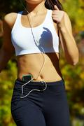close-up of a young woman jogging - stock photo