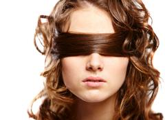Portrait of woman covering eyes by her hair Stock Photos