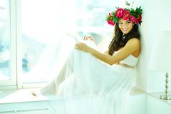 beautiful woman in white dress posing before camera - stock photo