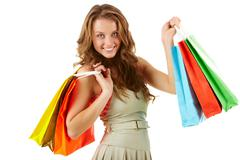 A girl with paper bags looking at camera and smiling Stock Photos