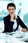 Photo of smart businesswoman looking at camera Stock Photos