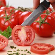 Preparing food: sliced tomato Stock Photos