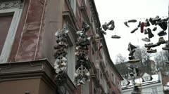 SHOES DANGLING FROM THE SKY - stock footage