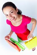 Portrait of young woman holding colorful paperbags Stock Photos