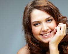 Portrait of happy female touching her face and laughing Stock Photos