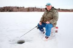 Ice fishing on the lake Stock Photos