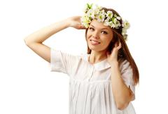 Image of happy female with floral wreath on head looking at camera Stock Photos