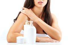 Skin cleansers by a beautiful woman Stock Photos