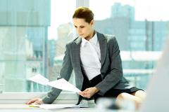 Photo of smart businesswoman working with papers in office Stock Photos