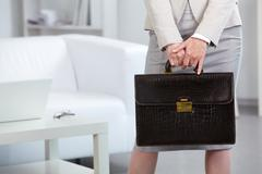 Close-up of businesswoman holding briefcase Stock Photos