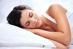 Stock Photo of portrait of a young girl sleeping on a pillow