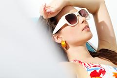 close-up of a sunbathing young girl's face - stock photo