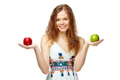 portrait of a girl holding red and green apples - stock photo