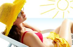Portrait of a girl lying in the sun in chaise lounge Stock Photos