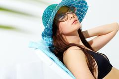 portrait of a beautiful sunbathing girl - stock photo