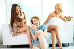 group of pretty girls spending their time at home together - stock photo