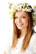 Image of happy female wearing floral wreath on head Stock Photos
