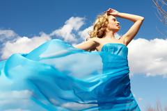 a young girl in streaming blue dress - stock photo