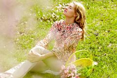 Image of pretty blonde taking pleasure in summer day Stock Photos