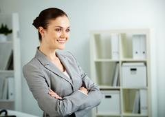 Portrait of smiling businesswoman in office Stock Photos