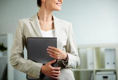 Close-up of businesswoman holding folder in hands Stock Photos