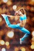 young girl making acrobatic leap - stock photo