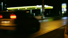Gas station at night defocused - stock footage