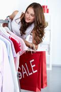 Young woman at clothing store at sales period Stock Photos