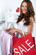 Portrait of happy woman with shopping bags at sales period Stock Photos