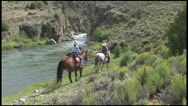 Stock Video Footage of Cowgirls Riding Along Colorado RIVER