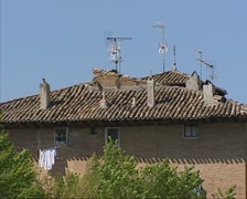 Stone tiled roof of spanish house with antennas + laundry Stock Footage